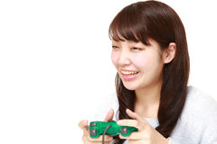 Young Japanese woman enjoying a video game Royalty Free Stock Image