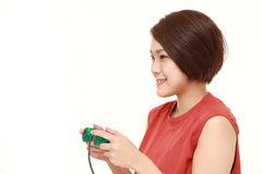 Young Japanese woman enjoying a video game Royalty Free Stock Photography