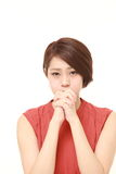 Young Japanese woman folding her hands in prayer Royalty Free Stock Photo