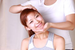 Young Japanese woman getting chiropractic Stock Images