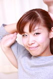 Young Japanese woman getting chiropractic Royalty Free Stock Photography