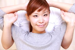 Young Japanese woman getting chiropractic Stock Photography