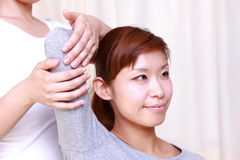 Young Japanese woman getting chiropractic Stock Photos