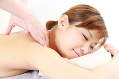 Young Japanese woman getting a massage Stock Images