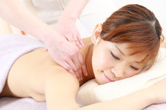 Young Japanese woman getting a massage Stock Photography