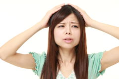 Young Japanese woman has lost her memory Royalty Free Stock Photo