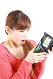 Young Japanese woman looking at her empty wallet Royalty Free Stock Photo