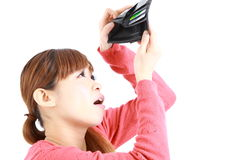 Young Japanese woman looking at her empty wallet Royalty Free Stock Image