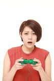 Young Japanese woman losing playing video game Stock Images