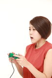 Young Japanese woman losing playing video game Royalty Free Stock Image