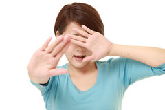 Young Japanese woman making stop gesture Stock Images