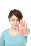 young Japanese woman making stop gesture Royalty Free Stock Photography