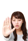 Young Japanese woman making stop gesture Royalty Free Stock Photos