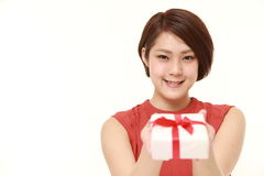 Young Japanese woman offering a gift Stock Photo