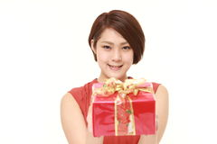 Young Japanese woman offering a gift Stock Image