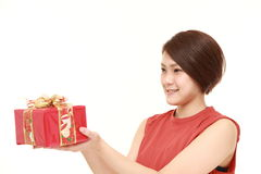Young Japanese woman offering a gift Stock Photography