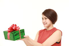 Young Japanese woman offering a gift Royalty Free Stock Image