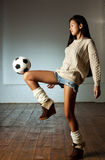 Young japanese woman playing football Royalty Free Stock Images