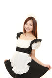 Young Japanese woman posing in french maid costume Royalty Free Stock Image