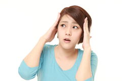 Young Japanese woman shocked Stock Photos