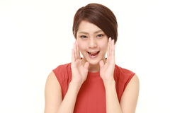 Young Japanese woman shout something. Studio shot of young Japanese woman on white background stock photos