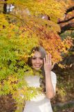 Young japanese woman showing her engagement ring in the autumn park Stock Photo