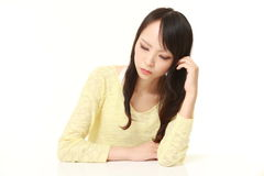 Young Japanese Woman Sleeping on the Table Royalty Free Stock Photos