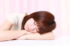 Young Japanese Woman Sleeping on the Table Stock Images