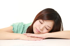Young Japanese Woman Sleeping on the Table Royalty Free Stock Image