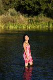 Young Japanese Woman Standing In River Smiling Wet Dress. Attractive Smiling Japanese Woman Standing In River With Wet Dress Stock Photos