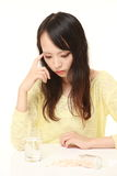 Young Japanese woman suffers from melancholy  Royalty Free Stock Images