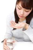 Young Japanese woman suffers from melancholy Stock Images