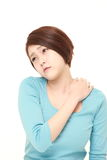 Young Japanese woman suffers from neck ache Royalty Free Stock Image