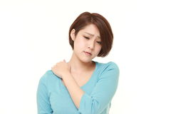 Young Japanese woman suffers from neck ache Stock Photography
