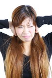 Young Japanese woman suffers from noise Stock Photo