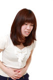 Young Japanese woman suffers from stomachache Stock Photography