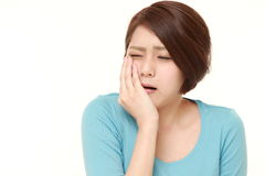 Young Japanese woman suffers from toothache Royalty Free Stock Image