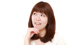 Young Japanese woman thinks about something Stock Photography
