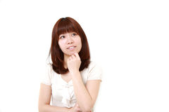 Young Japanese woman thinks about something Royalty Free Stock Photos