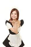 Young Japanese woman wearing french maid costume blowing a kiss Royalty Free Stock Photo