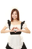 Young Japanese woman wearing french maid costume with heart Royalty Free Stock Photography