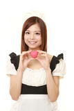 Young Japanese woman wearing french maid costume with pink heart Stock Photo
