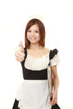 Young Japanese woman wearing french maid costume with thumbs up gesture Royalty Free Stock Image