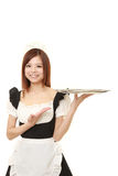Young Japanese woman wearing french maid costume with tray Stock Photos