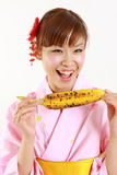 Young Japanese woman wearing kimono with grilled c Royalty Free Stock Photo