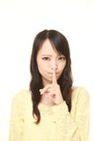 Young Japanese woman whith silence gestures Stock Photography