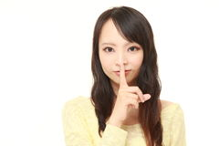 Young Japanese woman whith silence gestures Royalty Free Stock Photos
