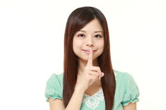 Young Japanese woman whith silence gestures Royalty Free Stock Image