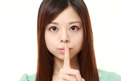 Young Japanese woman whith silence gestures Stock Photo
