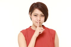 Young Japanese woman whith silence gestures Royalty Free Stock Images